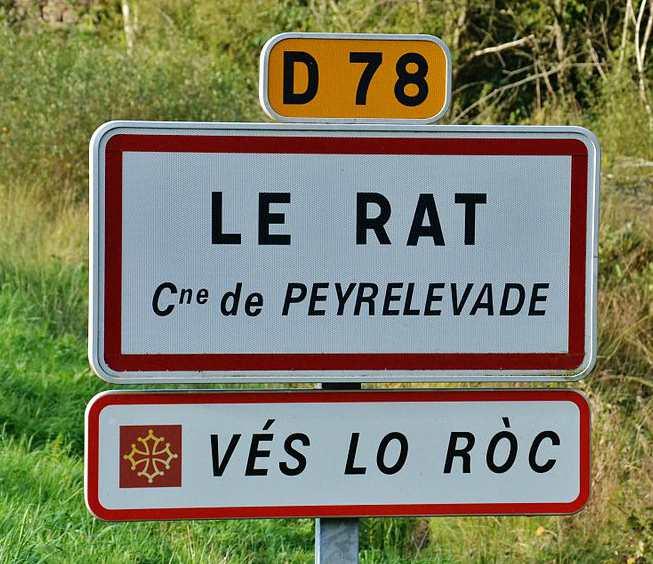 Cartello bilingue francese-occitano nel centro della Francia. Provenzale, occitano, aranés, catalano e valenciano fanno parte di una famiglia linguistica.